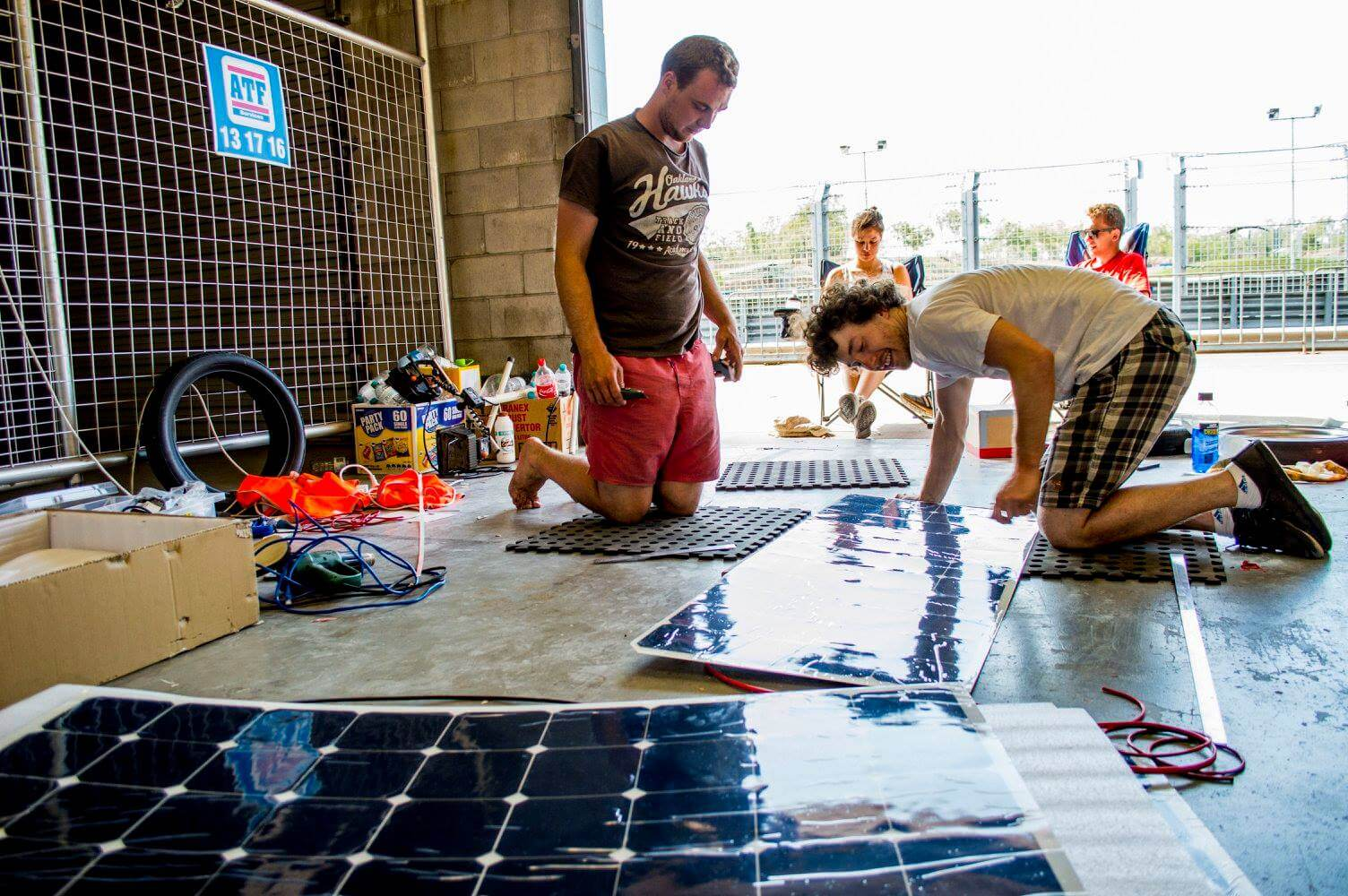 Installing flexible solar panels onto AURST world solar challenge entry