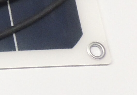 eyelets in each corner of flexible solar panel