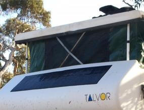 Black flexible solar panel on the front of a motorhome