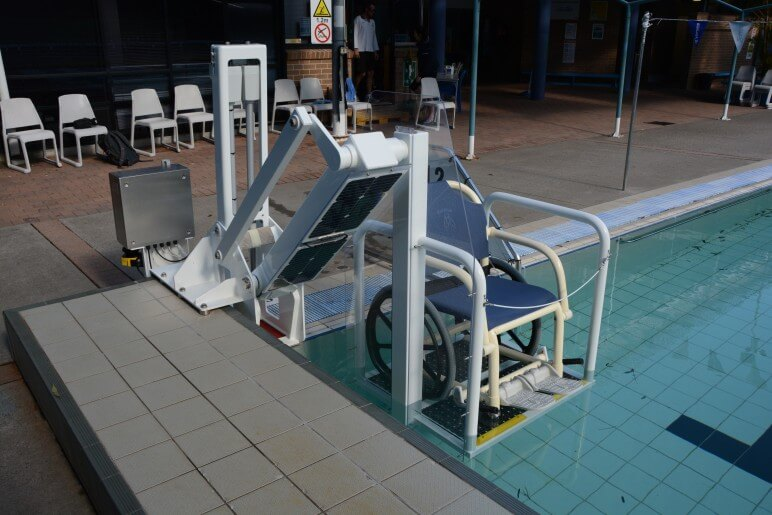 solar powered pool lift in action at Wollongong University swimming pool