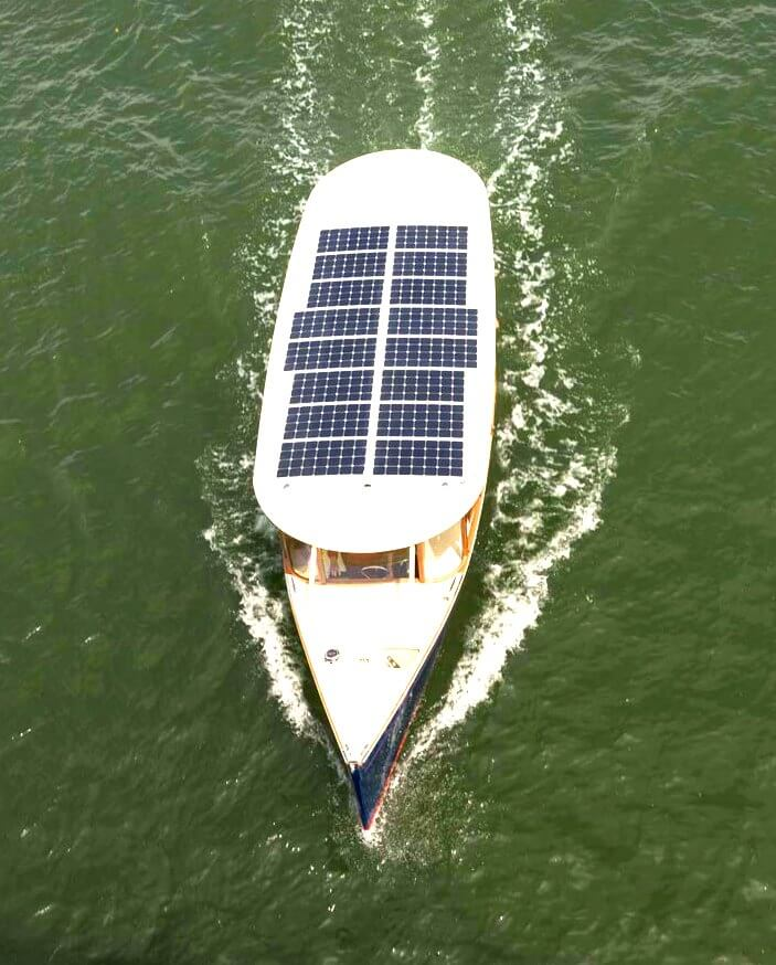 Solar Electric tourist operating with flexible solar panels and Victron controllers