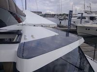 Black custom shaped flexible panels on catamaran